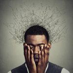 48484621 - depressed worried young man with worried desperate stressed expression hands covering face and brain melting into lines question marks. depression, anxiety disorders, life failure. gray background