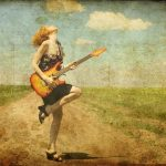 10690262 - rock girl with guitar at countryside. photo in old color image style.