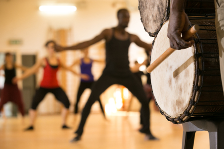 56206692 - dance class with instructor and close up of african drums