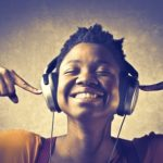 12199716 - smiling african woman listening to music