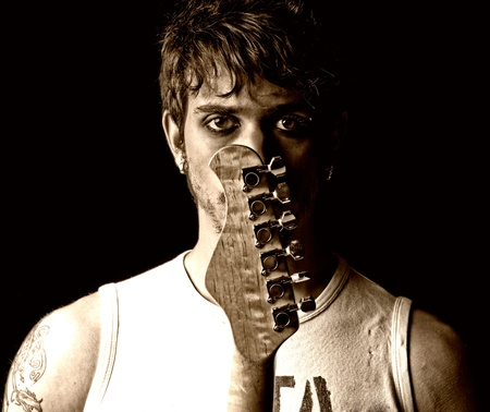 12325561 - young man with guitar portrait grunge punk rock
