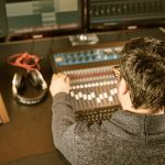 51732915 - sound engineer is working on a mixing console in a sound studio