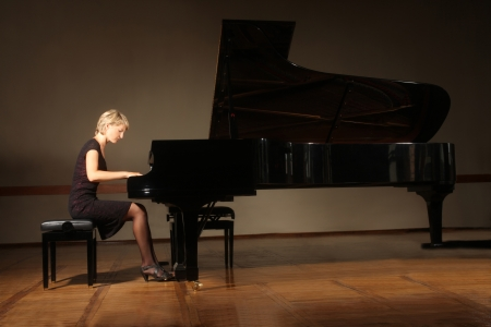 22203572 - grand piano pianist playing concert