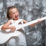 39462188 - beautiful little girl in white dress with her guitar