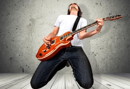 47406915 - guitarist.