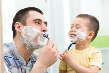 58617024 - happy child boy have fun with dad shaving in the bathroom
