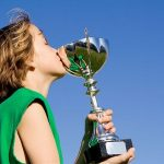 2650372 - child winner kissing sports trophy