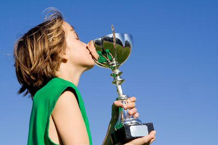 2650372 - child winner kissing sports trophy