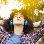 54897718 - young man listening music with earphones