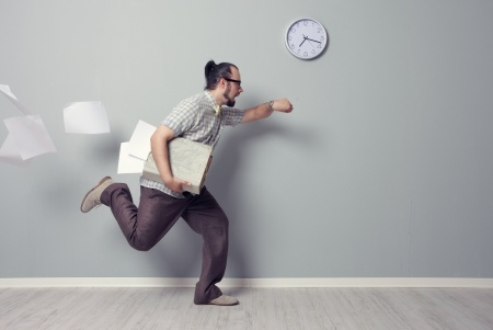 21772443 - stressed business man rushing in the office