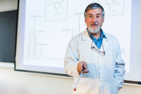 28325774 - senior chemistry professor giving a lecture in front of classroom full of students