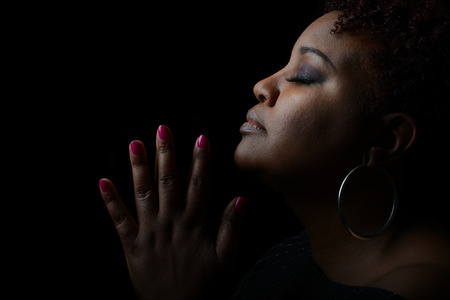 37109149 - very nice emotional image of a beautiful afro american woman giving thanks