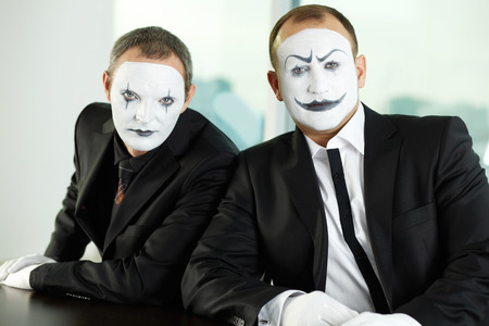 64022426 - portrait of two mimes representing business people