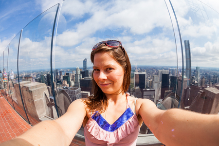 53815167 - girl taking selfies with view to uptown manhattan