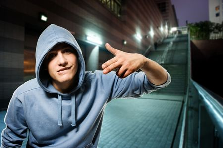 6034987 - young handsome men in a hood outdoors