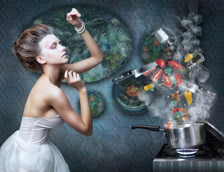 14335981 - beautiful emotional woman in kitchen interior cooking art creative concept