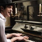 22853969 - he� got creative soul. handsome young men playing piano and singing