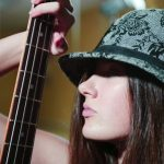 8088891 - young beautiful woman with guitare