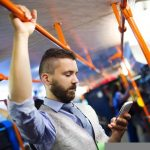32450024 - handsome hipster modern man calling by mobile phone in tram in night